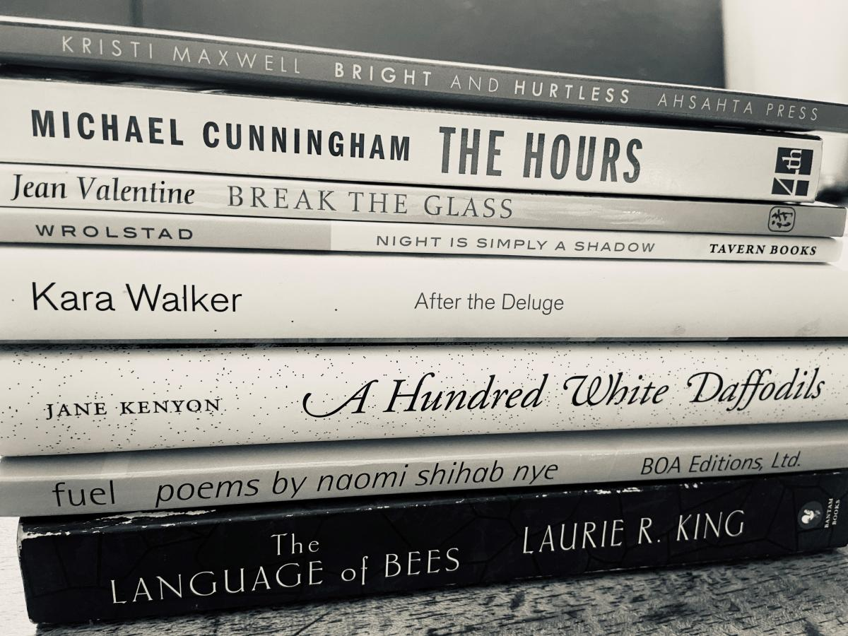 Image of book spines stacked to make a poem