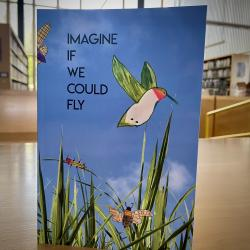 """Book that reads """"Even when we bend"""" with a bird on it, grass, and a blue background"""