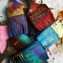 Dirty paint brushes in various colors, image by Rhonda K